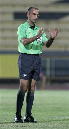 Referee Ali Sabbagh gestures during the AFC Cup soccer match between Kuwait's Al Qadsia and Yemen's Al Saqr in Kuwait City April 12, 2011. REUTERS/Tariq AlAli/Files