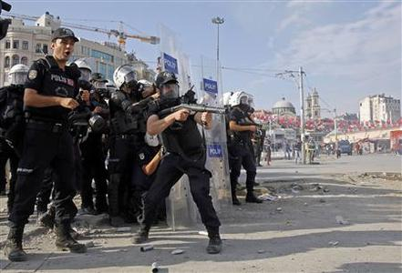 Turkish riot police fire water cannon and teargas during a protest at Taksim Square in Istanbul June 11, 2013. REUTERS-Yannis Behrakis