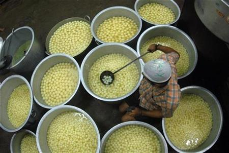 A worker prepares sweets inside a factory in Chennai November 3, 2010. REUTERS/Babu/Files