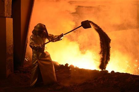 A steel-worker is pictured at a furnace at the plant of German steel company Salzgitter AG in Salzgitter, Lower Saxony on March 21, 2012. REUTERS/Fabian Bimmer