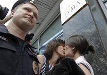 "Gay rights activists kiss during a protest against a proposed new law termed by the State Duma, the lower house of Parliament, as ""against advocating the rejection of traditional family values"" in central Moscow June 11, 2013. REUTERS/Maxim Shemetov"