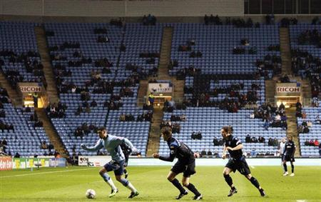 Coventry City play Portsmouth in front of a sparse crowd during their FA Cup soccer match at the Ricoh Arena in Coventry, central England January 12, 2010. REUTERS/Darren Staples