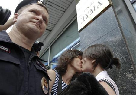 Gay rights activists kiss during a protest against a proposed new law termed by the State Duma, the lower house of Parliament, as ''against advocating the rejection of traditional family values'' in central Moscow June 11, 2013. REUTERS/Maxim Shemetov