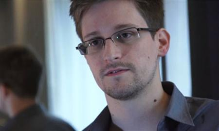 National Security Agency whistleblower Edward Snowden, an analyst with a U.S. defence contractor, is seen in this still image taken from a video during an interview with the Guardian in his hotel room in Hong Kong June 6, 2013. REUTERS/Courtesy of The Guardian/Glenn Greenwald/Laura Poitras/Handout