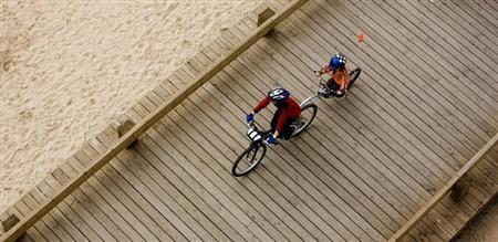 A mother rides a bicycle with her son near the seaside in Portimao, southern Portugal March 4, 2007. REUTERS/Nacho Doce