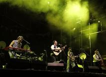 English folk rock band Mumford and Sons' Marcus Mumford (2nd L), Winston Marshall (2nd R), Ted Dwane (R) and Ben Lovett (L) perform on the main stage during the second day of the Coachella Valley Music & Arts Festival in Indio, California April 16, 2011. REUTERS/Mike Blake