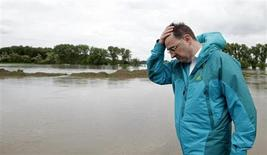Czech Republic's Prime Minister Petr Necas reacts as he visits the flooded village of Zalezlice, 30km (18.6 miles) north from Prague, June 4, 2013. REUTERS/David W Cerny