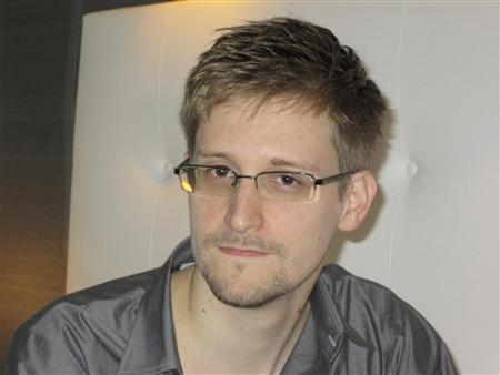 U.S. National Security Agency whistleblower Edward Snowden, an analyst with a U.S. defence contractor, is pictured during an interview with the Guardian in his hotel room in Hong Kong June 9, 2013. REUTERS/Ewen MacAskill/The Guardian/Handout