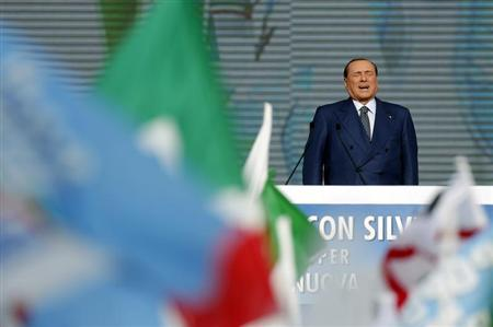 Italy's former Prime Minister Silvio Berlusconi attends during a meeting in Rome March 23, 2013. REUTERS/Yara Nardi