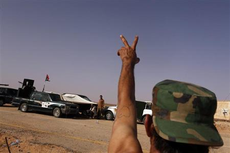 Libyan army chief urges rebels to join the army