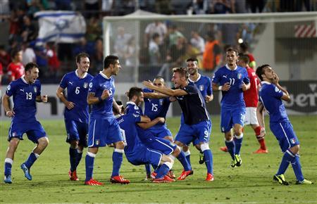 Itay's Andrea Bertolacci (5th L) celebrates with teammates after scoring a goal against Norway during their European Under-21 Championship soccer match against Norway at Bloomfield Stadium in Tel Aviv June 11, 2013. REUTERS/Nir Elias