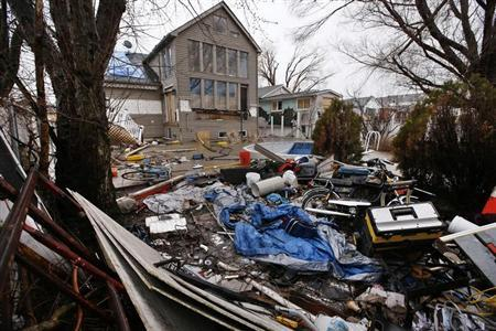 A home destroyed and abandoned after Hurricane Sandy is seen on Fox Beach Avenue in the Oakwood Beach section of Staten Island in New York City, New York, March 25, 2013. REUTERS/Mike Segar