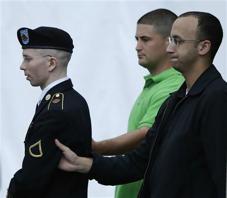 U.S. Army Private First Class Bradley Manning (L) departs the courtroom after day four of his court martial at Fort Meade, Maryland June 10, 2013. REUTERS/Gary Cameron