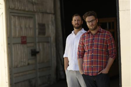 Directors and writers Seth Rogen (R) and Evan Goldberg pose for a portrait while promoting their upcoming movie ''This Is the End'' at Sony Studios in Culver City, California June 3, 2013. The movie opens in the U.S. on June 12. REUTERS/Mario Anzuoni