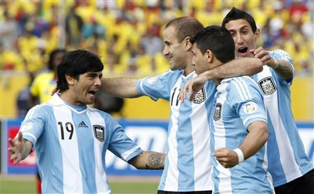 Argentina's Sergio Aguero (2nd R) and teammates Ever Banega (L), Rodrigo Palacio and Angel Di Maria celebrate (R) after Aguero scored a goal against Ecuador in their 2014 World Cup qualifying soccer match in Quito June 11, 2013. REUTERS/Gary Granja