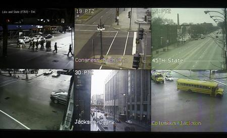 Screens displaying views from cameras located on the streets of Chicago are seen at the Chicago Emergency Communication Center, January 12, 2007. REUTERS/Joshua Lott