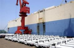 New trucks manufactured by Chinese automaker Chery are parked before being loading for export, next to a ship at a port in Lianyungang, Jiangsu province June 2, 2013. REUTERS/Stringer