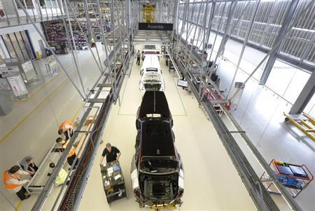 Employees work on the production line for the Rolls Royce Ghost at the Rolls Royce Motor Cars factory at Goodwood near Chichester in southern England April 24, 2013. REUTERS/Luke MacGregor