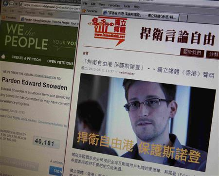 A statement by Hong Kong online media ''In Media Hong Kong'' supporting Edward Snowden, a contractor at the National Security Agency (NSA), is displayed alongside a petition to ''Pardon Edward Snowden'' on a White House website, on a computer screen in Hong Kong in this June 12, 2013 illustration photo. REUTERS/Bobby Yip