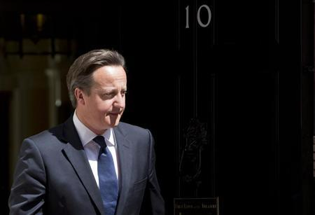 Britain's Prime Minister David Cameron waits at Downing Street to meet Columbia's President Juan Manuel Santos Calderon in London June 6, 2013. REUTERS/Neil Hall
