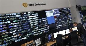 File picture shows employees of Germany's biggest cable operator, Kabel Deutschland, working in front of a monitor wall at the Kabel Deutschland playout centre in Frankfurt February 25, 2013. REUTERS/Lisi Niesner/Files