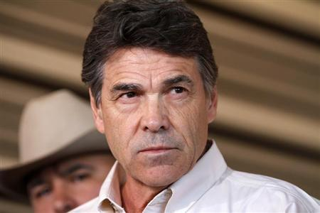 Texas Governor Rick Perry answers questions from the media after taking an aerial tour over the fertilizer plant explosion site in West, Texas, April 19, 2013. REUTERS/Jaime R. Carrero