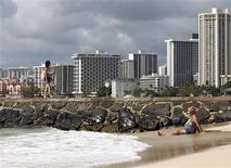 Beachgoers are pictured at Waikiki Beach in Honolulu, Hawaii November 9, 2011. REUTERS/Chris Wattie