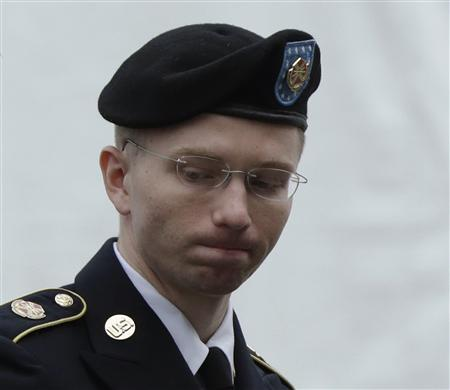 U.S. Army Private First Class Bradley Manning enters the courtroom for day four of his court martial at Fort Meade, Maryland in this June 10, 2013, file photo. REUTERS/Gary Cameron/Files