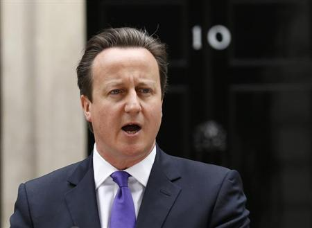 Britain's Prime Minister David Cameron speaks in front of 10 Downing Street, about the killing of a British soldier, in London May 23, 2013. REUTERS/Olivia Harris
