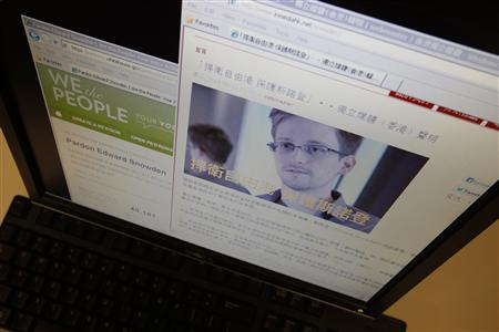 A statement by Hong Kong online media platform ''In Media Hong Kong'' supporting Edward Snowden, a contractor at the National Security Agency (NSA), is seen alongside a petition ''Pardon Edward Snowden'' at the White House website, on a computer screen in Hong Kong in this June 12, 2013 illustration photo. REUTERS/Bobby Yip