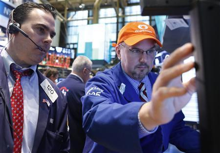 Trader Michael Iozzi and specialist trader John Urbanowicz (R) work on the floor at the New York Stock Exchange, June 12, 2013. REUTERS/Brendan McDermid