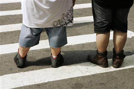 Pedestrians wait to walk across a street near Times Square in New York in this August 28, 2007 file photo. Wildwood, New Jersey voted on June 12, 2013 to ban saggy pants on its two-mile stretch of boardwalk. Offenders whose pants hang lower than three inches from the waist could be fined up to $200, and the statute also requires shirts to be worn on the boardwalk between 8 p.m. and 5 a.m. REUTERS/Lucas Jackson/Files