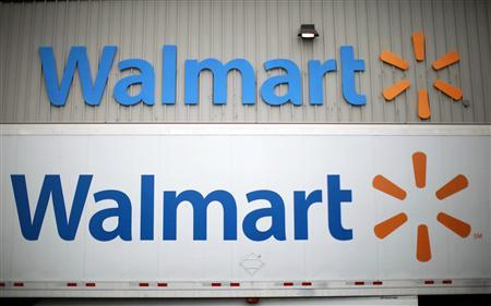 Wal-Mart Stores Inc logos is seen at a company distribution center in Bentonville, Arkansas, in this June 6, 2013 file photo. REUTERS/Rick Wilking/Files