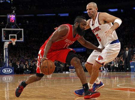 Houston Rockets guard James Harden (L) drives to the basket defended by New York Knicks point guard Jason Kidd in the second quarter of their NBA basketball game at Madison Square Garden in New York, December 17, 2012. REUTERS/Adam Hunger