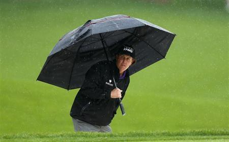 Phil Mickelson of the U.S. reviews his shot from the greenside bunker on the 15th hole during the final round of the Wells Fargo Championship PGA golf tournament at the Quail Hollow Club in Charlotte, North Carolina May 5, 2013. REUTERS/Chris Keane