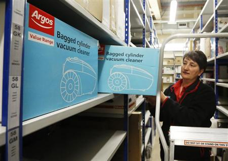 An employee poses in the storeroom of an Argos Extra store in Ashford south east England May 1, 2013. REUTERS/Luke MacGregor