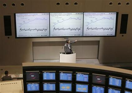 A man speaks during a seminar about stock investment at Tokyo Stock Exchange June 10, 2013. REUTERS-Yuya Shino