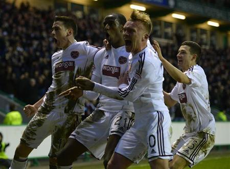 Hearts' Michael Ngoo (2nd L) celebrates his goal with teammates Jamie Walker (L) and Fraser Mullen (2nd R) against Inverness Caledonian Thistle during their Scottish League Cup semi-final soccer match at Easter Rd Stadium in Edinburgh, Scotland January 26, 2013. REUTERS/Russell Cheyne