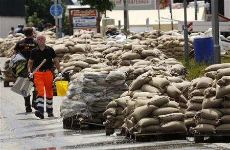 Used sandbags are piled up in the streets of Fischerdorf, a suburb of the eastern Bavarian city of Deggendorf June 11, 2013, after the floods of the nearby Danube river subsided. REUTERS/Wolfgang Rattay