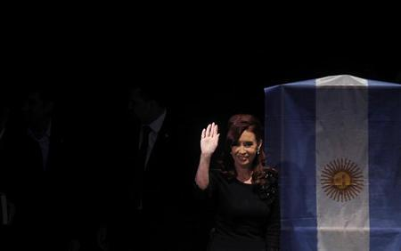 Argentina's President Cristina Fernandez de Kirchner waves as she arrives for the inauguration of a university in Buenos Aires May 16, 2013. REUTERS/Marcos Brindicci
