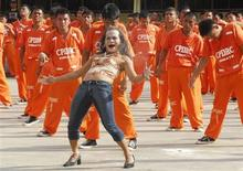 "More than 1500 inmates of the Cebu Provincial Detention and Rehabilitation Center perform Michael Jackson's ""Thriller"" dance in celebration of a religious festival in Cebu City central Philippines January 18, 2008. REUTERS/Victor Kintanar"