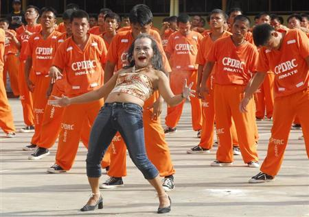 More than 1500 inmates of the Cebu Provincial Detention and Rehabilitation Center perform Michael Jackson's ''Thriller'' dance in celebration of a religious festival in Cebu City central Philippines January 18, 2008. REUTERS/Victor Kintanar