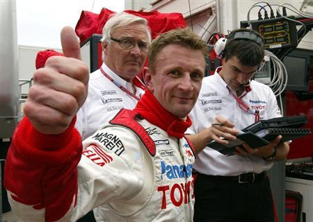 Panasonic Toyota driver Allan McNish of Britain reacts after he clocked the second time of the free practice session of Monaco Formula One Grand Prix in Monte Carlo May 23, 2002.