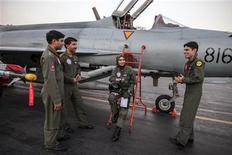 Ayesha Farooq, 26, (C) Pakistan's only female war-ready fighter pilot, chats with her colleagues beside a Chinese-made F-7PG fighter jet at Mushaf base in Sargodha, north Pakistan June 6, 2013. REUTERS/Zohra Bensemra