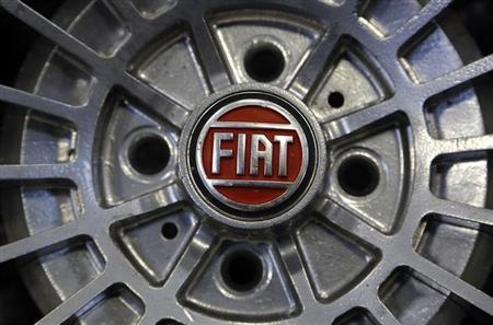 A Fiat logo is seen on the wheel of a Fiat car in Turin in this picture taken February 10, 2013. Shares of Italian automaker turned negative in midday trading after its U.S. unit Chrysler posted worse-than-expected first quarter results on April 29, 2013. REUTERS/Stefano Rellandini