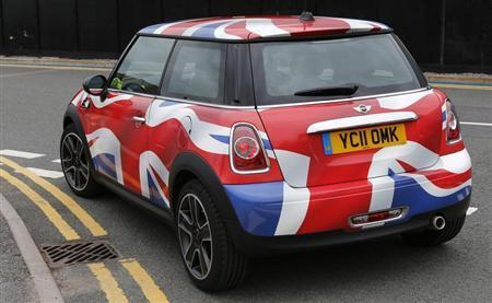A Mini painted with a Union flag is seen at the car making plant in Oxford, western England July 9, 2012. REUTERS/Eddie Keogh