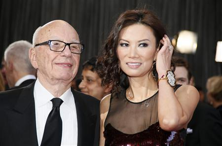 Rupert Murdoch, chairman and CEO of News Corporation, arrives with his wife Wendi Deng at the 85th Academy Awards in Hollywood, California in this February 24, 2013 file photo. REUTERS/Lucy Nicholson/File
