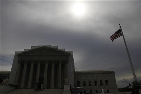 The sun shines through cloud cover above the U.S. Supreme Court building in Washington, June 13, 2013. The U.S. Supreme Court on Thursday issued a mixed ruling in a case concerning patents held by Myriad Genetics Inc over the closely watched issue of whether human genes can be patented. REUTERS/Jonathan Ernst