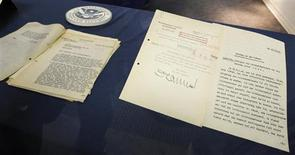 Papers from the recovered diary of Nazi leader Alfred Rosenberg are displayed during a news conference at the Department of Homeland Security office in Wilmington, Delaware, June 13, 2013. The U.S. government has recovered 400 pages from the long-lost diary of Rosenberg, a confidant of Adolf Hitler who played a central role in the extermination of millions of Jews and others during World War Two. Picture taken through a glass panel. REUTERS/Tim Shaffer