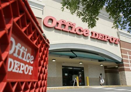 A customer leaves an Office Depot store in Arlington, Virginia July 28, 2009. REUTERS/Richard Clement